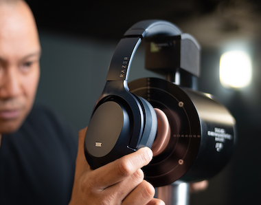 A man testing the Razer Opus headphones