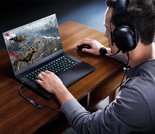 THX Onyx Guy Playing War Zone on Razer Laptop